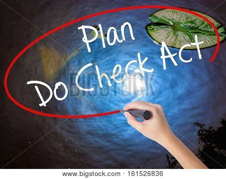 Woman Hand Writing Plan Do Check Act  With Marker Over Transparent Board