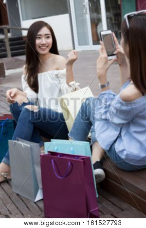 Happy Asian Woman With Colorful Shopping Bags Take Photo At Department Store Shopping Mall, Blur Bac