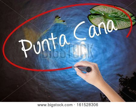Woman Hand Writing Punta Cana With Marker Over Transparent Board
