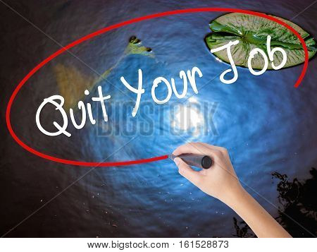 Woman Hand Writing Quit Your Job With Marker Over Transparent Board.