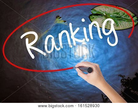 Woman Hand Writing Ranking With Marker Over Transparent Board