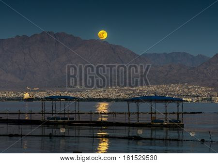 Super-moon above Jordanian mountains, The photo was taken from the beach of Eilat in Israel