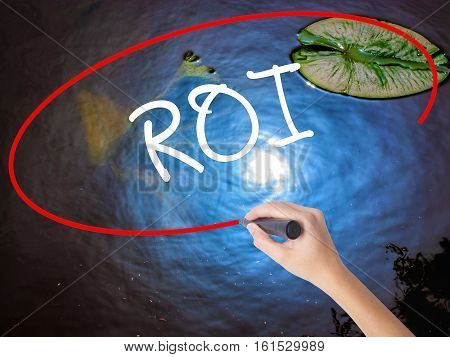 Woman Hand Writing Roi (return On Investment)  With Marker Over Transparent Board