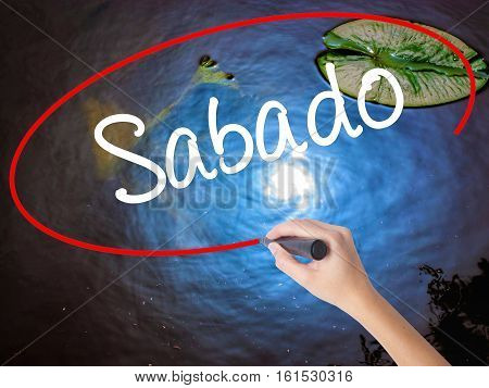 Woman Hand Writing Sabado (saturday In Spanish/portuguese) With Marker Over Transparent Board