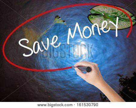 Woman Hand Writing Save Money With Marker Over Transparent Board