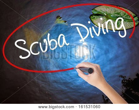 Woman Hand Writing Scuba Diving With Marker Over Transparent Board