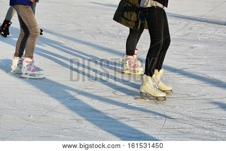 CLUJ-NAPOCA ROMANIA - DECEMBER 11 2015: Young people skate on ice skating rink