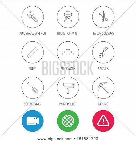 Screwdriver, scissors and adjustable wrench icons. Spatula, mining tool and paint roller linear signs. Brickwork, ruler and painting icons. Video cam, hazard attention and internet globe icons. Vector