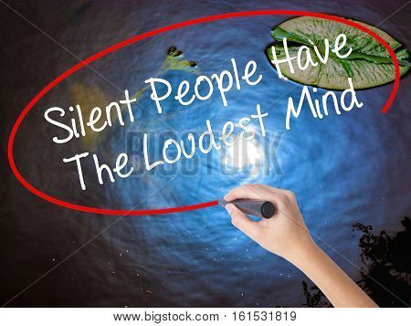 Woman Hand Writing Silent People Have The Loudest Mind With Marker Over Transparent Board