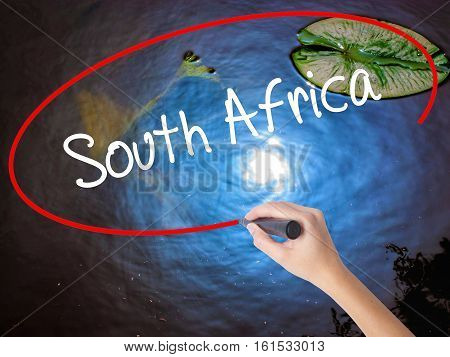 Woman Hand Writing South Africa With Marker Over Transparent Board