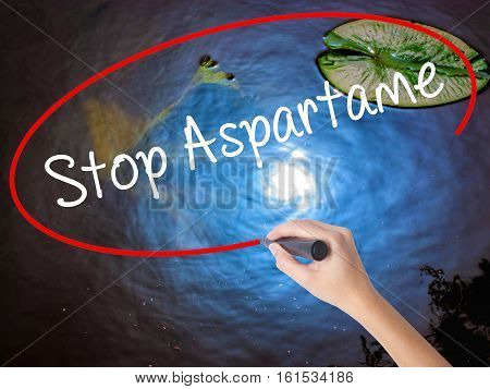 Woman Hand Writing Stop Aspartame With Marker Over Transparent Board