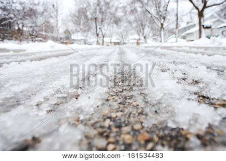 Icy street filled with slush in winter