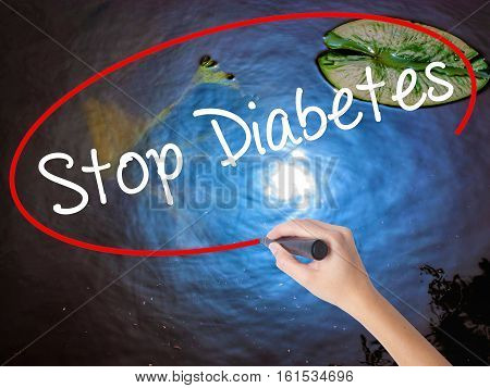 Woman Hand Writing Stop Diabetes With Marker Over Transparent Board
