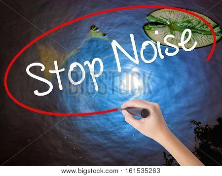 Woman Hand Writing Stop Noise   With Marker Over Transparent Board