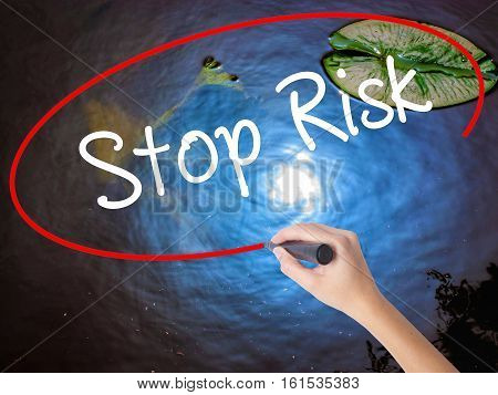 Woman Hand Writing Stop Risk With Marker Over Transparent Board