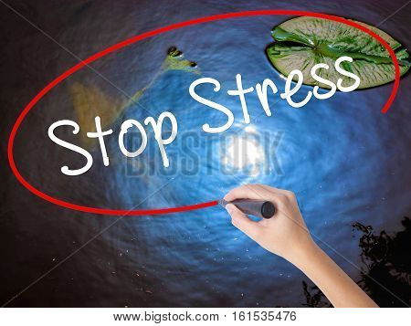 Woman Hand Writing Stop Stress With Marker Over Transparent Board