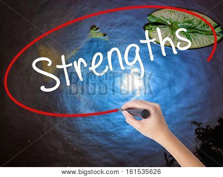 Woman Hand Writing Strengths With Marker Over Transparent Board.