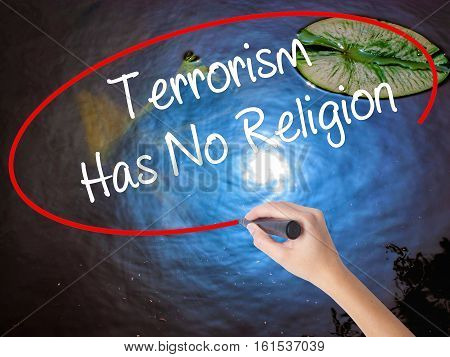 Woman Hand Writing Terrorism Has No Religion  With Marker Over Transparent Board
