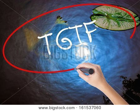 Woman Hand Writing Tgif With Marker Over Transparent Board