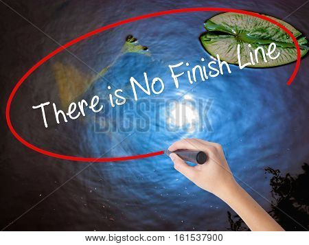 Woman Hand Writing There Is No Finish Line With Marker Over Transparent Board