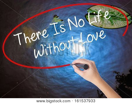 Woman Hand Writing There Is No Life Without Love With Marker Over Transparent Board