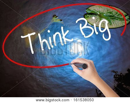 Woman Hand Writing Think Big With Marker Over Transparent Board