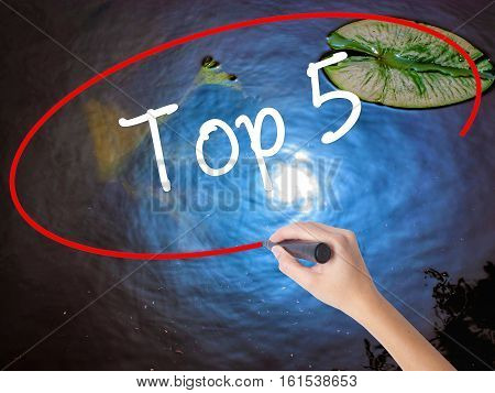 Woman Hand Writing Top 5 With Marker Over Transparent Board