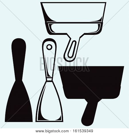 Putty knife. Construction tools. Isolated on blue background. Vector silhouettes