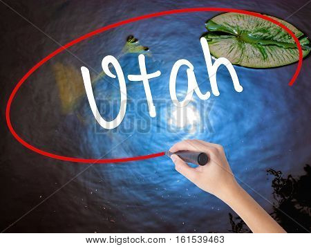 Woman Hand Writing Utah With Marker Over Transparent Board