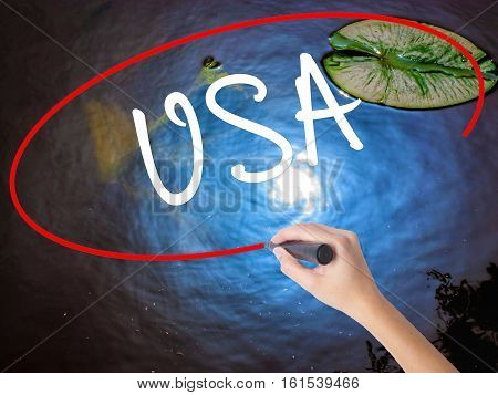 Woman Hand Writing Usa With Marker Over Transparent Board