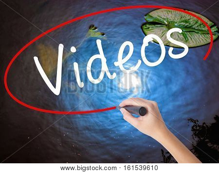 Woman Hand Writing Videos With Marker Over Transparent Board