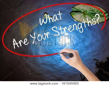 Woman Hand Writing What Are Your Strengths? With Marker Over Transparent Board