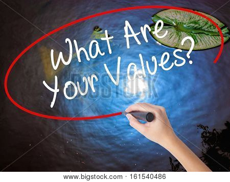 Woman Hand Writing What Are Your Values? With Marker Over Transparent Board