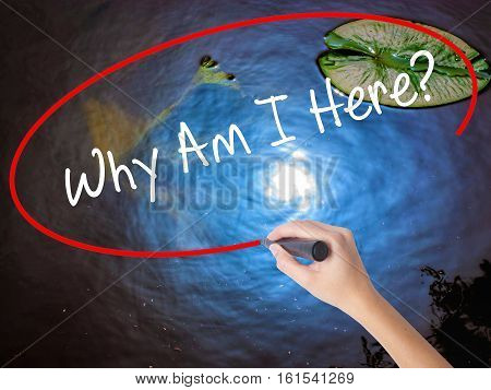 Woman Hand Writing Why Am I Here? With Marker Over Transparent Board