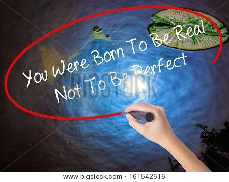 Woman Hand Writing You Were Born To Be Real Not To Be Perfect With Marker Over Transparent Board