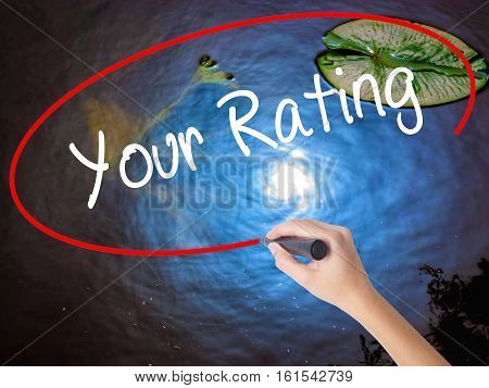 Woman Hand Writing Your Rating With Marker Over Transparent Board.