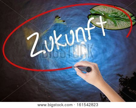 Woman Hand Writing Zukunft (future In German)  With Marker Over Transparent Board