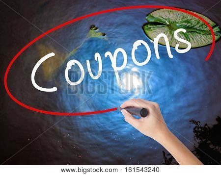 Woman Hand Writing Coupons Marker Over Transparent Board