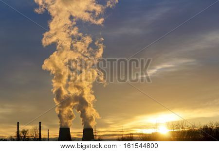 thermal power station thick with pipe smoke the smoke from the chimneys at sunset