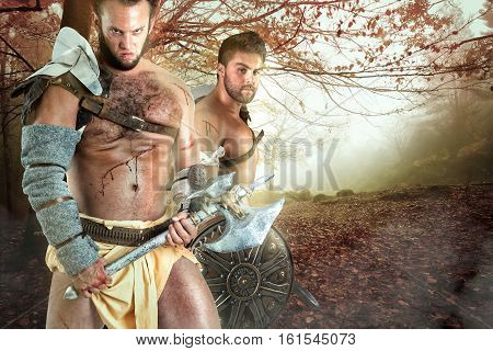 Barbarian warriors posing in a forest ready to battle