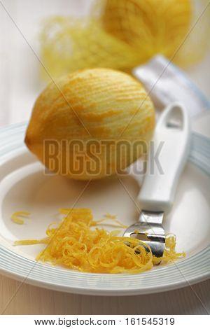 Just scraped lemon zest on a plate