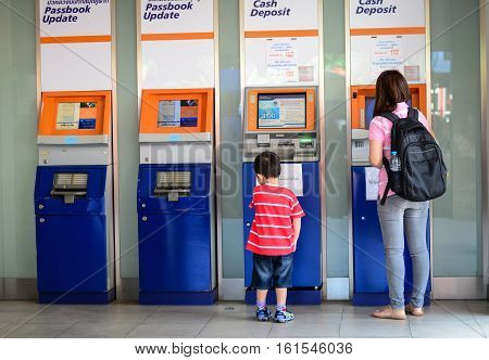 People Are Using Atm (automatic Teller Machine)