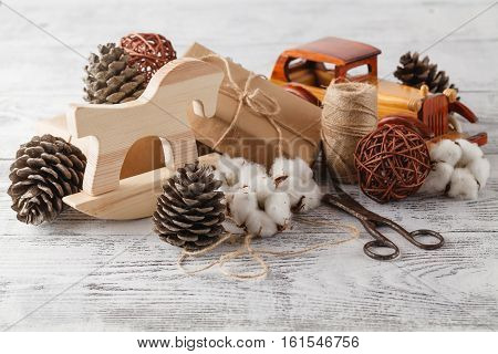 Wrapping Eco Christmas Packages With Brown Paper, String And Natural Branches And Decor Elements On