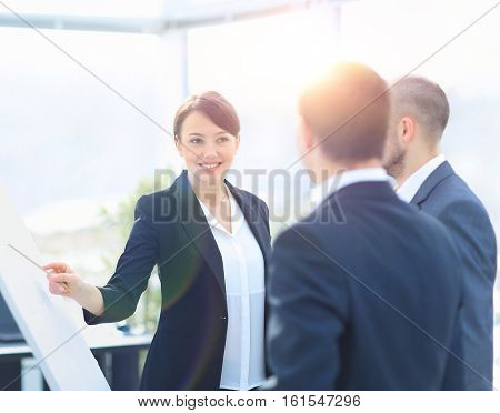 Portrait of executive businesswoman presenting his idea to his colleagues at meeting. Teamwork.