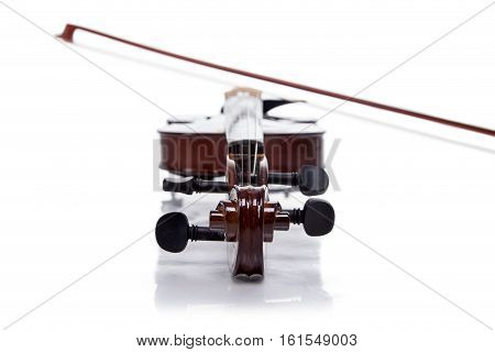 Wooden brown fiddle with stick on white background