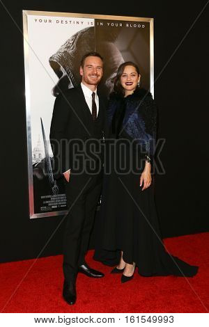NEW YORK-DEC 13: Michael Fassbender (L) and Marion Cotillard attend the screening of