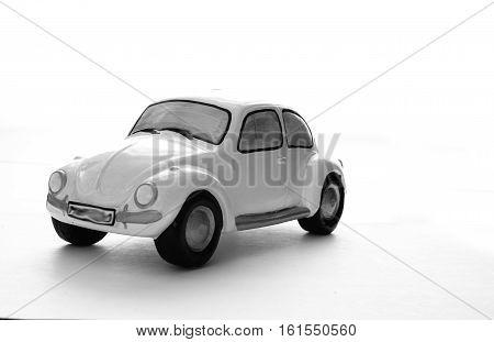 Reto ceramic white car on a white background, car piggy bank