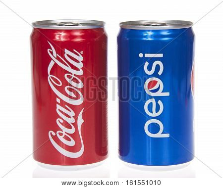Alameda CA - March 28 2016: Pepsi and Coca-Cola cans symbolic representation of one of the largest business rivalries of all time.