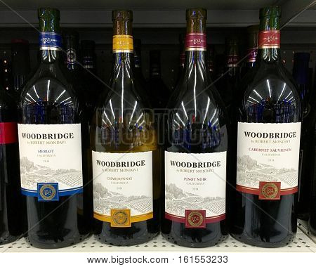 San Leandro CA - April 08 2016: Four bottles of Woodbridge wines by Robert Mondavi. Merlot Chardonnay Pinot Noir and a Cabernet Sauvignon.