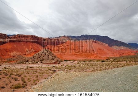 Impressions of the Canyon Quebrada de las Conchas with walls of rock displaying a multitude of red hues close to Cafayate in Chile South America